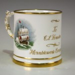 A Hammersley & Co mug hand-painted with two vignettes