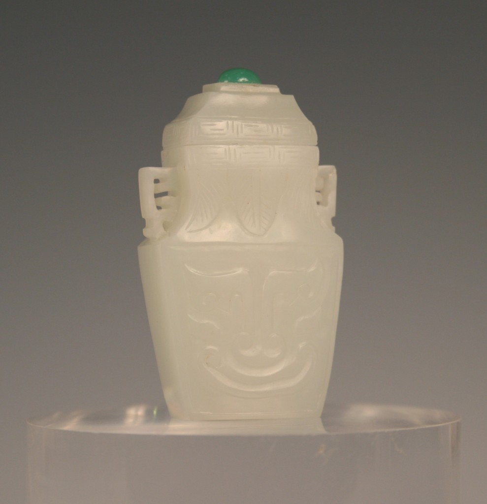 1108 A Chinese white jade diminuitive vase and cover