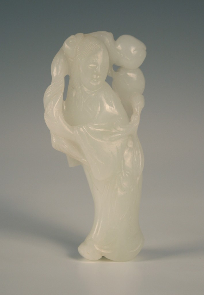 1113 A Chinese white jade carving of a maiden