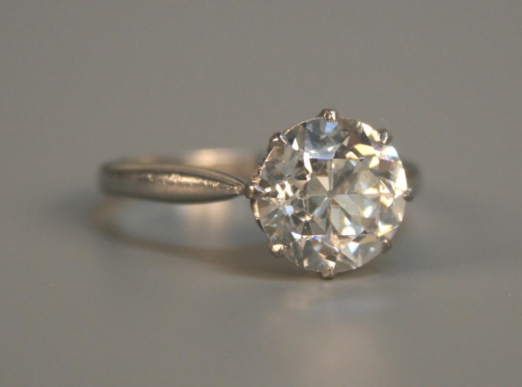 A platinum and diamond single stone ring