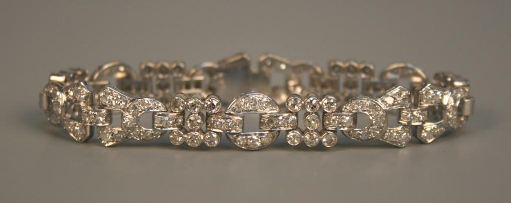 A diamond bracelet in a pierced circular link design