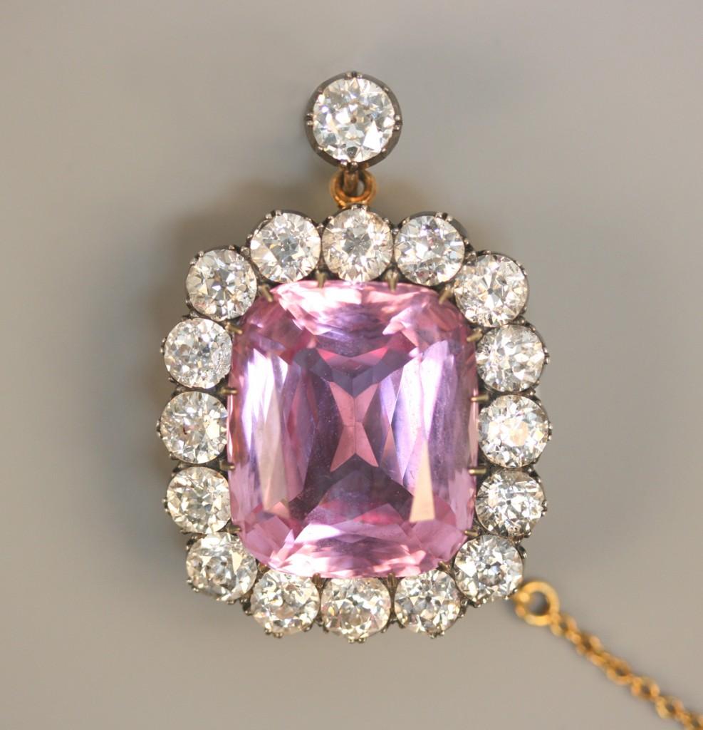 A diamond and pink beryl brooch