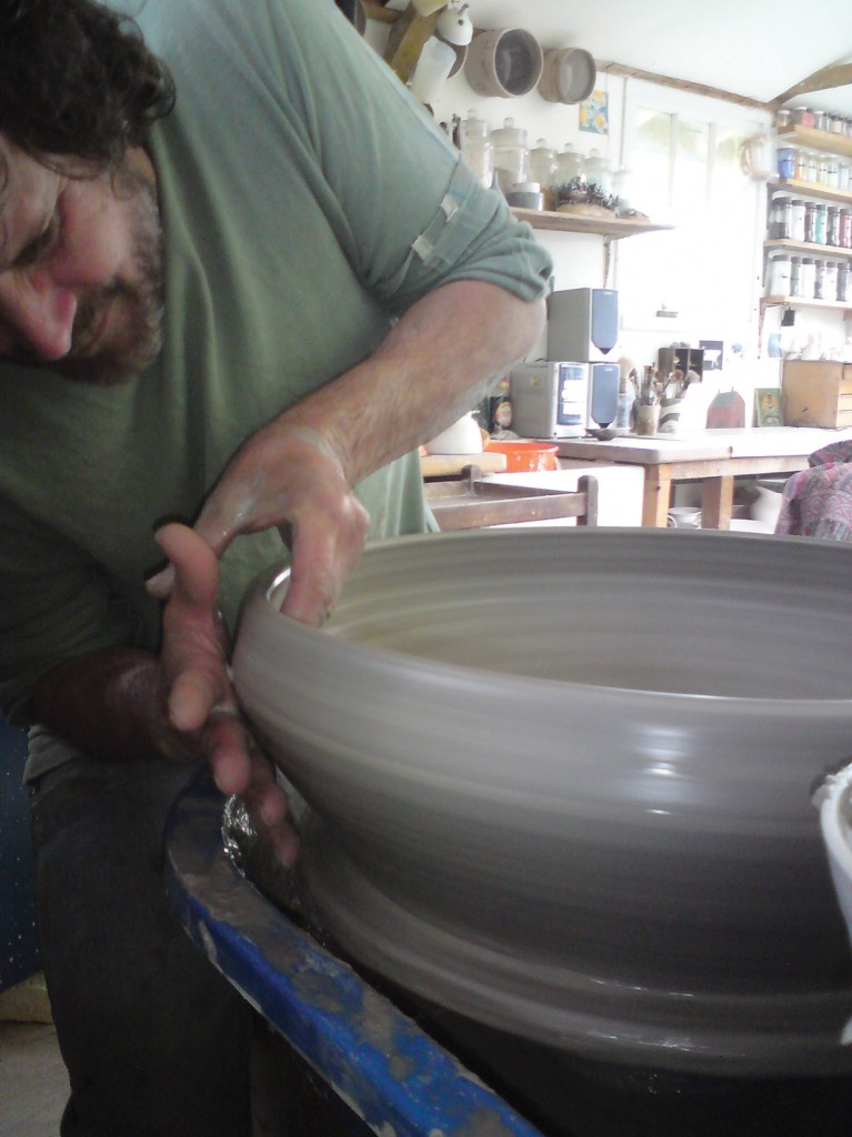 The artist Josse Davis working in his potter's studio