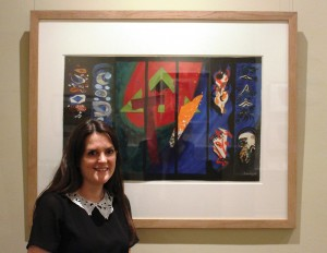 Katy Norris, Pallant House Curatorial Assistant and Exhibition Curator for Modern British Collage and its Legacy, with John Piper's preliminary collage design for the Chichester Cathedral tapestry, circa 1965.