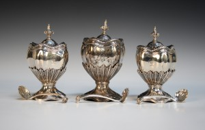 A set of three George II silver graduated tea caddies or condiment vases and covers by Nicholas Sprimont, London 1743