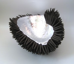 Claire Palastanga 'Strength' black earthenware with silver leaf