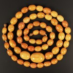 0644 - Amber beads at auction