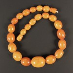 0646 - Amber beads at auction