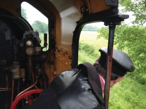 Driver Steve Squire on the footplate, heading up the Bluebell Line