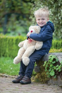 A teddy bear waiting with his young owner for the picnic to begin at Borde Hill!