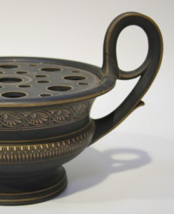 A Wedgwood black basalt combined bough-pot and pastille burner, 19th century