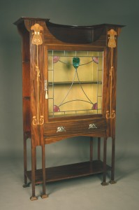 An Edwardian mahogany Art Nouveau display cabinet