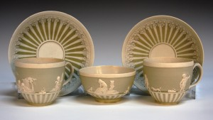A pair of Wedgwood two colour jasperware cups and saucers