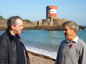Rupert Toovey and Frank Falle in conversation by Archirondel's Jersey Round Tower