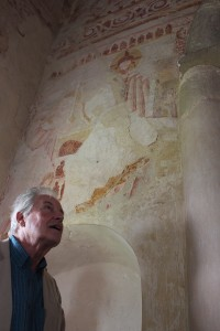 Professor Robin Milner-Gulland admires the frescoes at Clayton