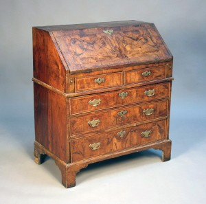 An 18th century walnut bureau with cross and feather banded borders