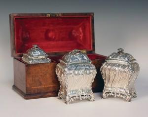 A set of three George III silver graduated tea caddies