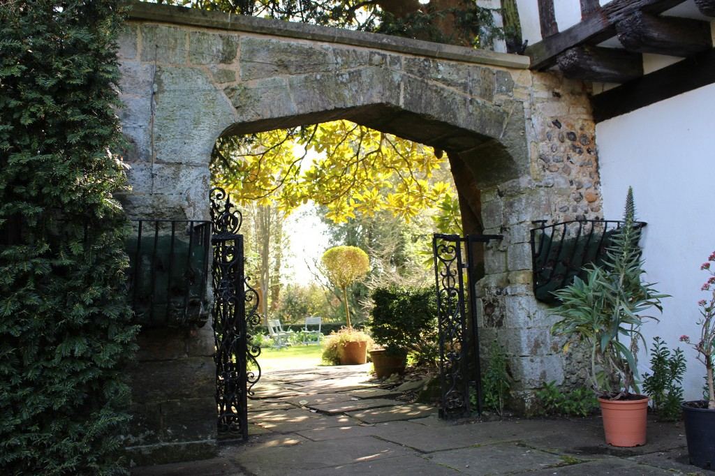 The Terrace Garden viewed through a wide stone arch