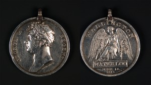 A Waterloo Medal with impressed naming to 'Quar. Mast. Ben. Sweeten, 1st Batt. 52nd Reg. Foot.'