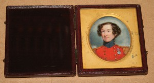 Circle of William Grimaldi - Oval Miniature Head and Shoulders Portrait of a British Military Officer in Uniform, decorated with a Waterloo Medal, early 19th Century watercolour on ivory
