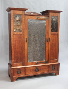 A Shapland & Petter oak and copper mounted wardrobe