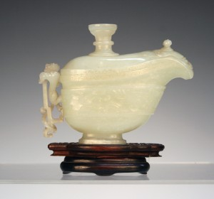 An 18th century Chinese archaistic jade libation vessel and cover, sold at Toovey's for £70,000