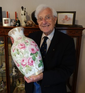 Geoffrey Godden admires a Minton's vase