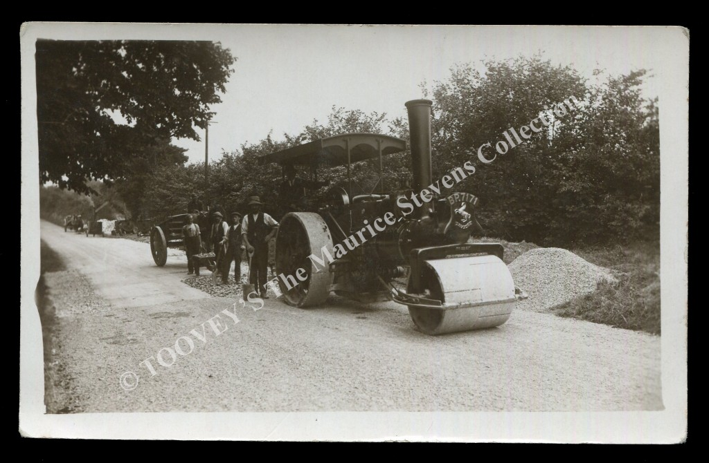 Lot 3019 a photographic postcard of a steam roller at Blackstone in West Sussex