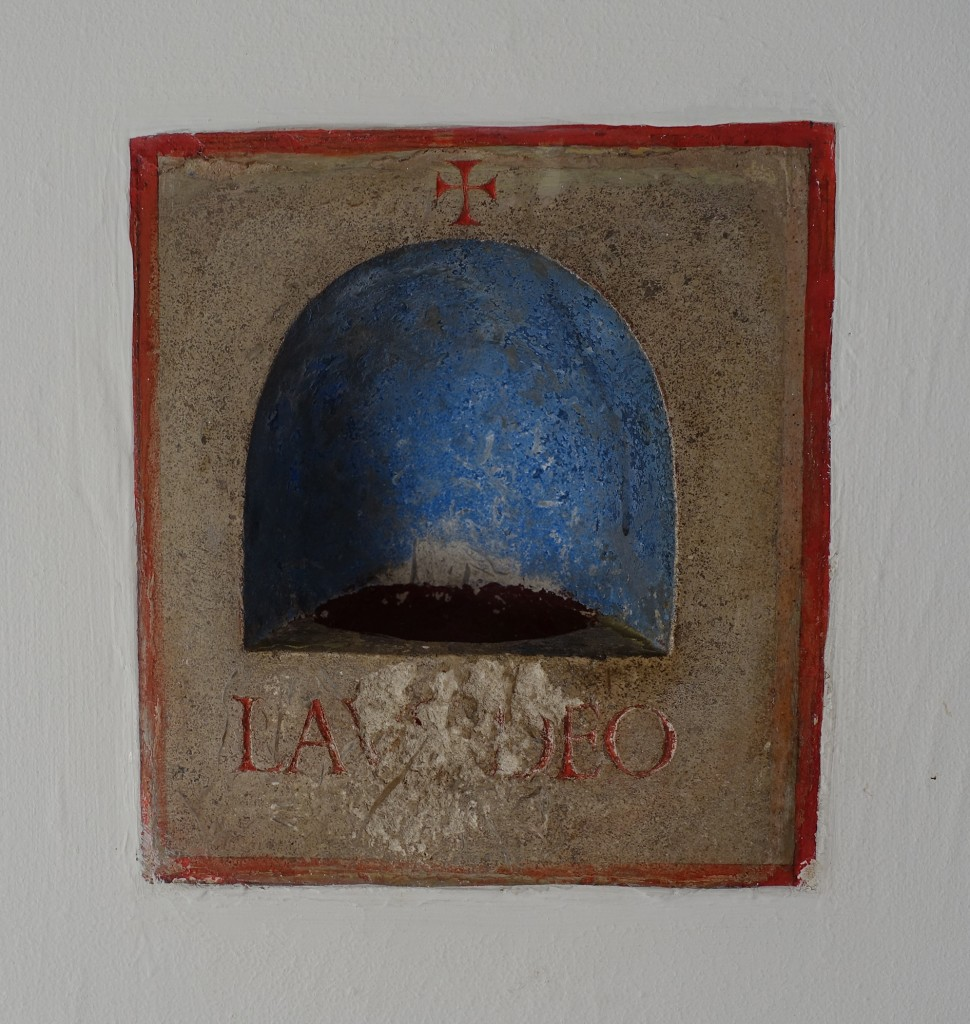 Eric Gill's carved and painted stone Lavabo in the hall