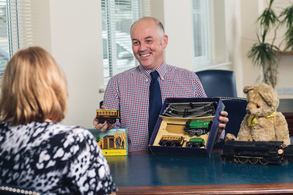 Toovey's toy specialist, Christopher Gale, offering advice on a collection of toys