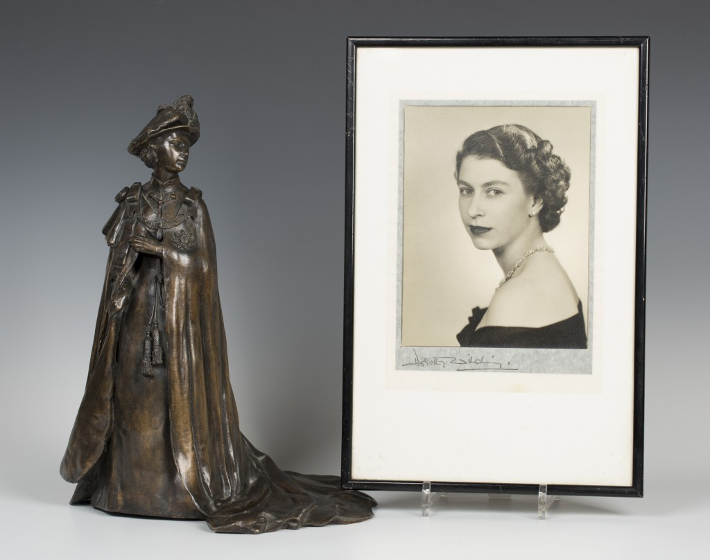 A Dorothy Wilding photographic portrait of Queen Elizabeth II and a Royal Worcester brown cast bronze Silver Jubilee figure of Her Majesty