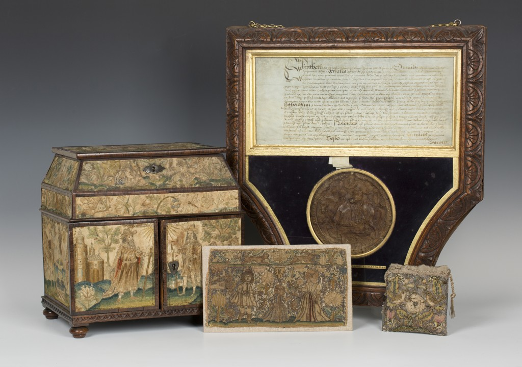 A group of antiquarian objects including: an Elizabeth I indenture on vellum, hung with the second Great Wax Seal, used between 1586-1603 and a 17th Century silkwork and rosewood banded table cabinet
