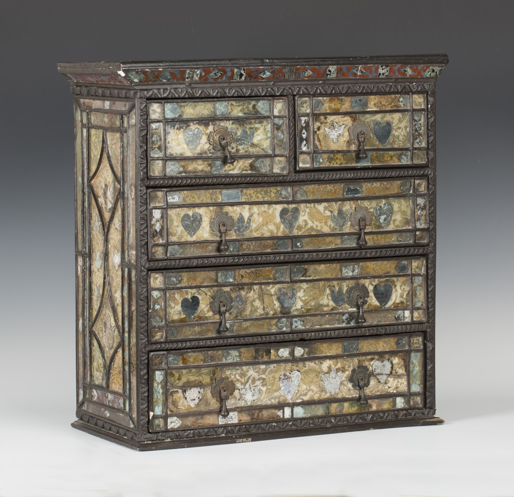 A 16th Century ebonized and verre églomisé table chest reputed to have belonged to Mary, Queen of Scots