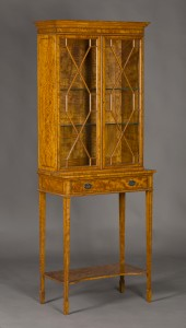 An Edwardian satinwood display cabinet-on-stand, probably housed originally at Sandringham