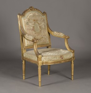 A Victorian giltwood open armchair of Neoclassical Louis XVI design, covered in Royal Windsor tapestry