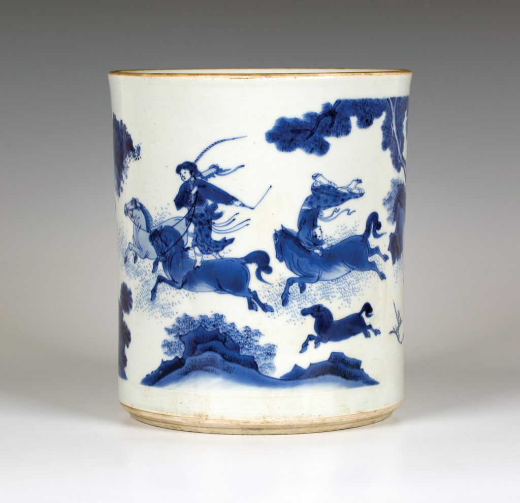 A £37,000 rare Chinese Transitional period, mid-17th Century, blue and white porcelain brush pot (bitong), decorated with horses and three female acrobat riders