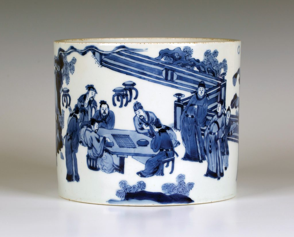 A £30,000 Chinese Kangxi period blue and white porcelain brush pot (bitong), finely painted with a continuous scene of poets and attendants indulging in scholarly pursuits
