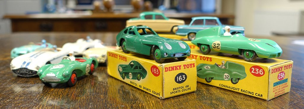 A Dinky Toys no. 163 Bristol 450 and Sports Coupé and no. 236 Connaught racing car both with their original boxes and an array of sports cars