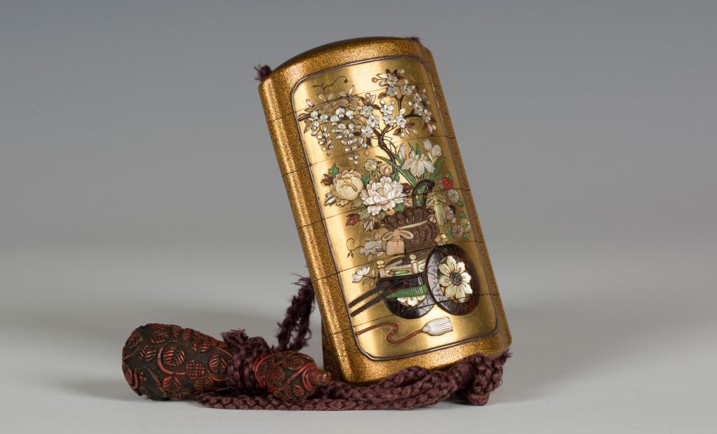 A Japanese lacquer and Shibayama inlaid five case inro, Meiji period (1868-1912), sold at Toovey's for £3200