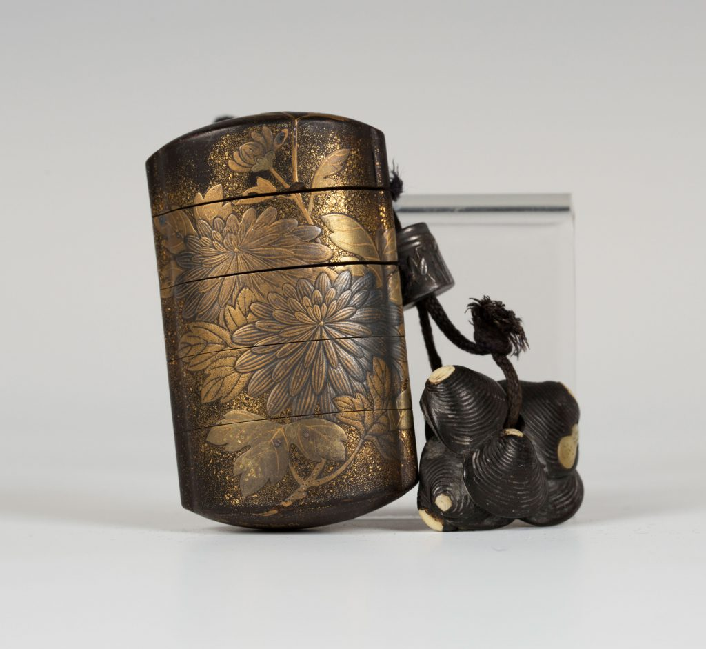 A Japanese four-case lacquer inro by Koma Koryu, Edo period, with netsuke (19th century)