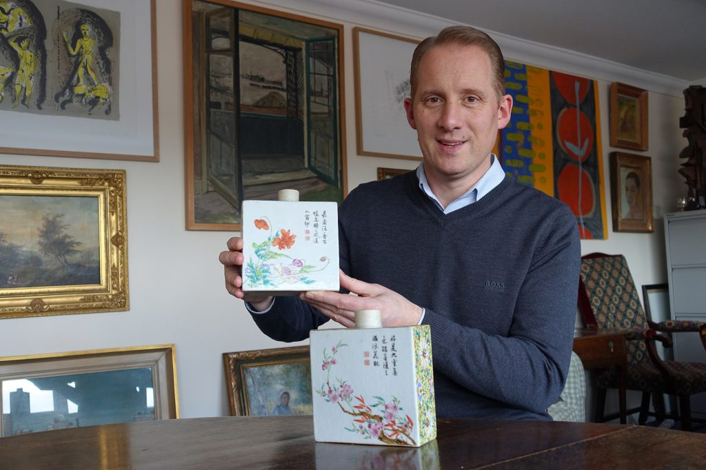 Toovey's Asian Art Specialist, Tom Rowsell, with the £132,000 pair of Qianlong period tea caddies
