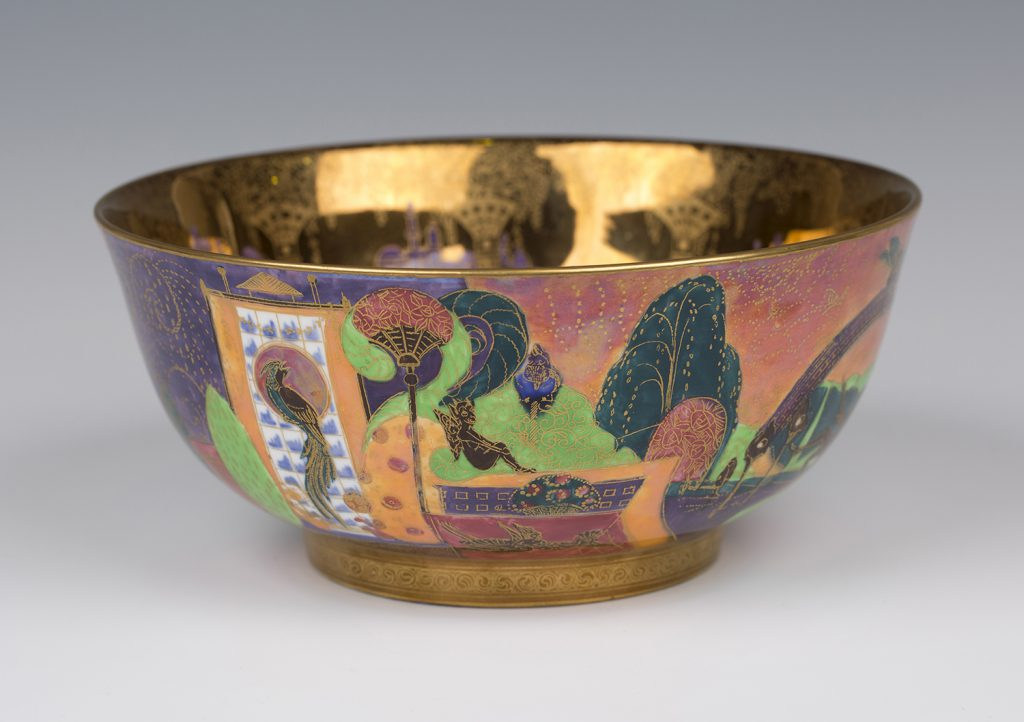A Wedgwood Fairyland Lustre Imperial shape bowl, designed by Daisy Makeig-Jones, the interior gilt and enamelled with Bird in a Hoop pattern against a flame ground, diameter 21cm