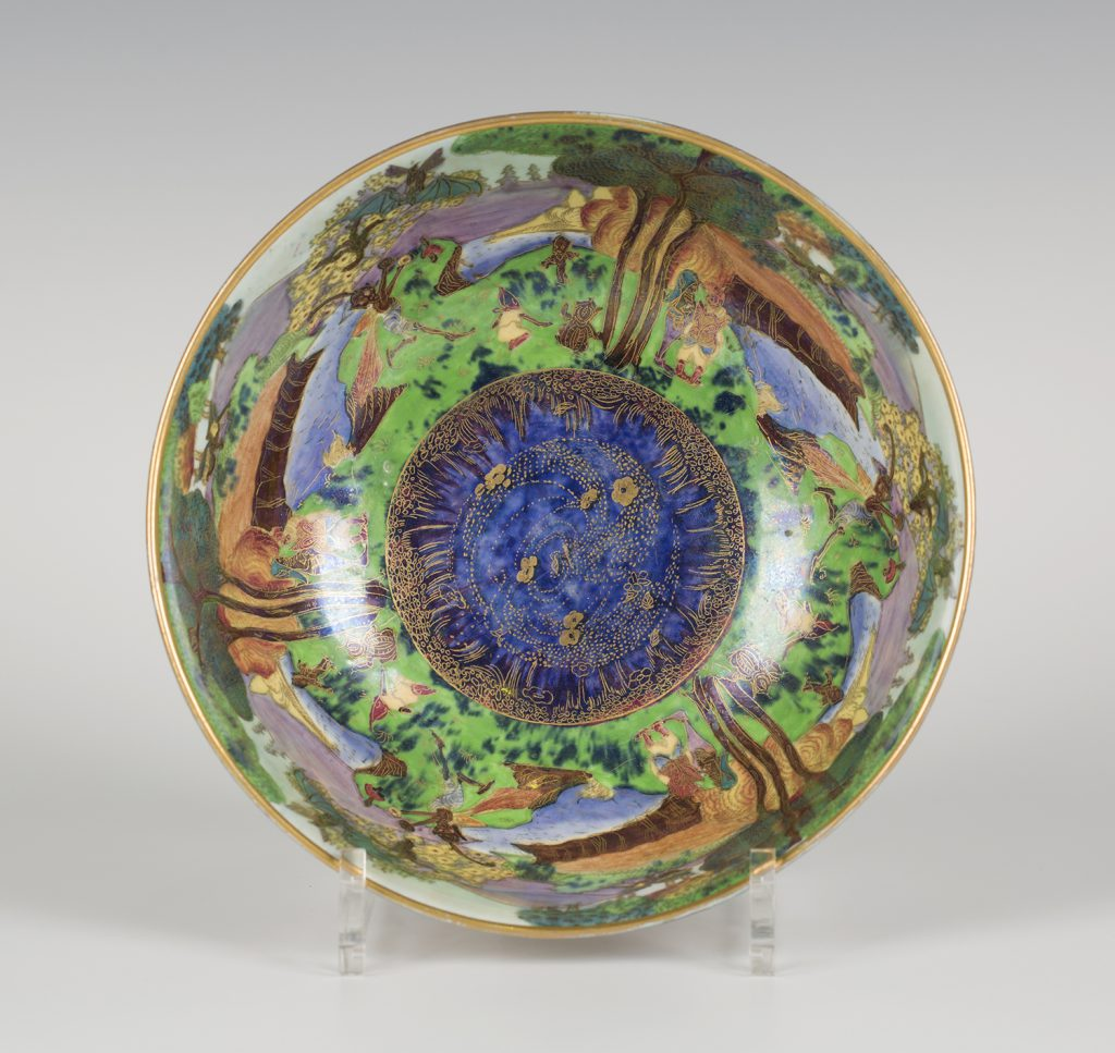 A Wedgwood Fairyland lustre Imperial shape bowl, designed by Daisy Makeig-Jones, the interior gilt and enamelled with Picnic by a River pattern, diameter 20cm