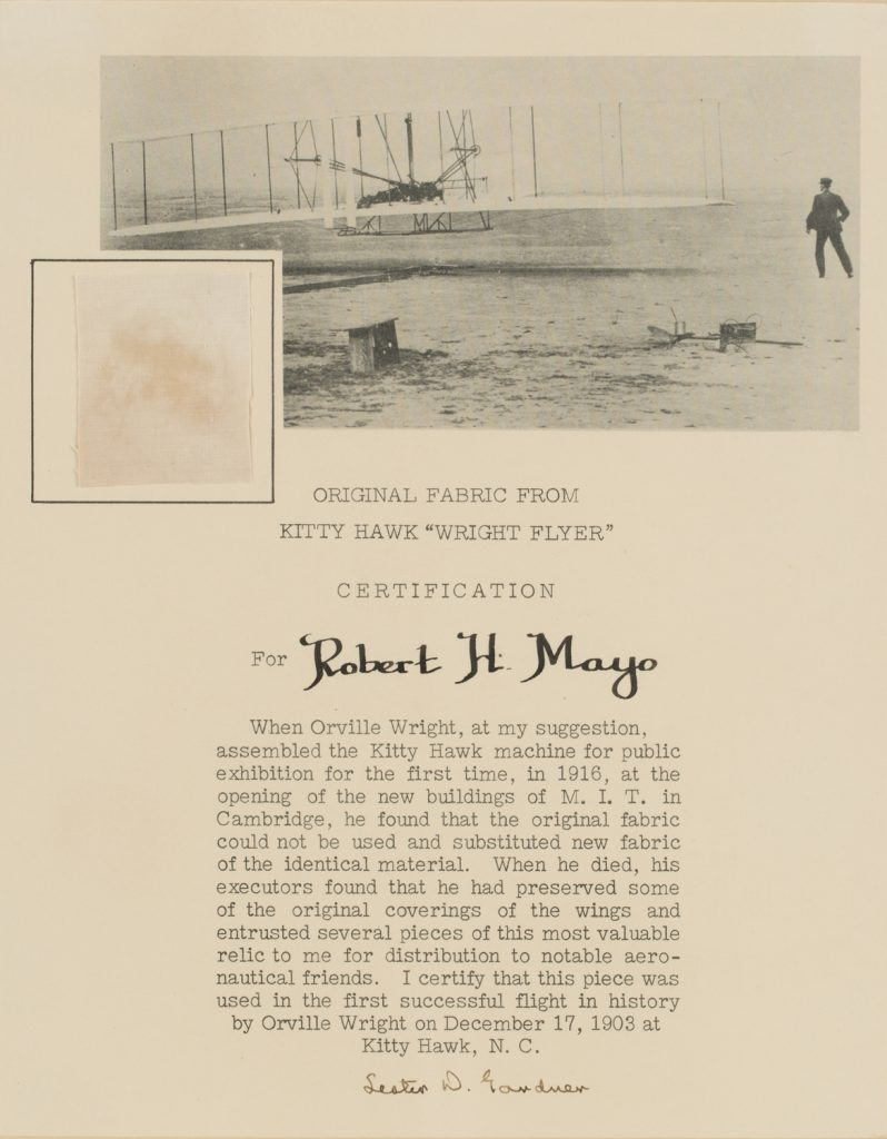 A small section of original fabric, 4.4cm x 3.7cm, from Kitty Hawk 'Wright Flyer' with printed certification for Robert H. Mayo