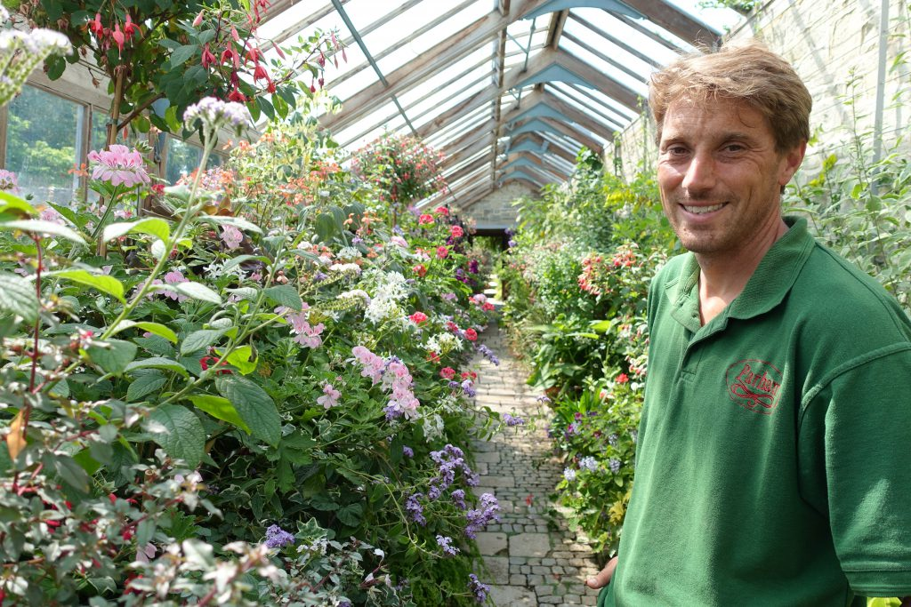 Parham's Head Gardener, Tom Brown, in the greenhouses at Parham