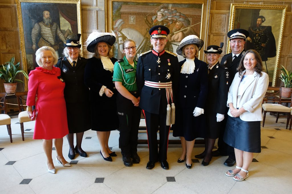 From left to right: Lady Fiona Barttelot, Caroline Lucas, Lady Emma Barnard, Katie Holmes, Peter Field, Maureen Chowen, Quenelda Avery, Trevor Moss and Liz Harper celebrating St John Ambulance in Sussex in the Great Hall at Parham