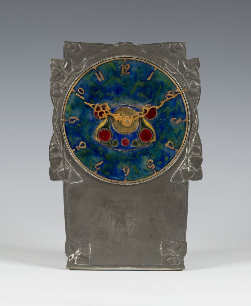A Liberty Tudric Arts & Crafts timepiece designed by Archibald Knox