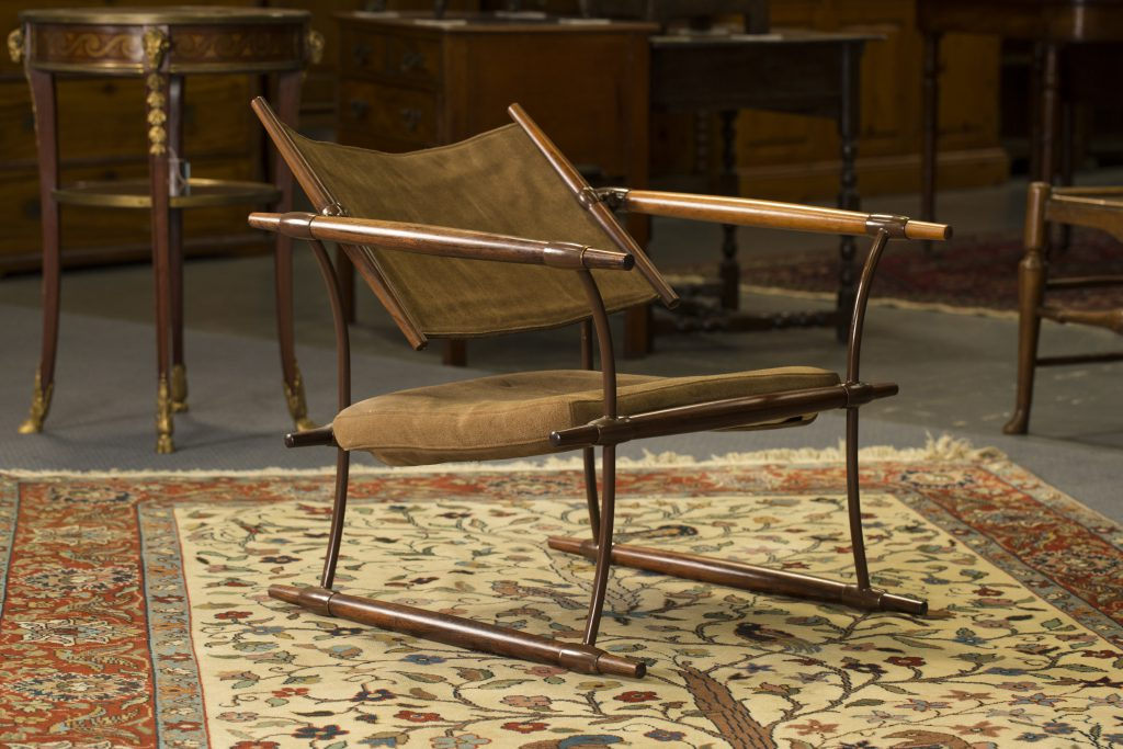 A rosewood and brown patinated metal armchair, circa 1965, designed by Jens Quistgaard