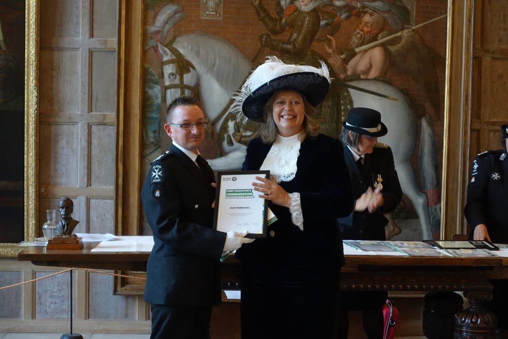 Lady Emma Barnard presenting a Commendation Award to Jean-Pierre Ball