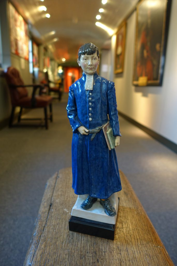 An earthenware figure of a Christ's Hospital boy modelled by Harry Parr, circa 1929